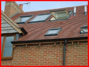 Clay Rosemary Roof Tiles with Fakro Roof Windows Installed