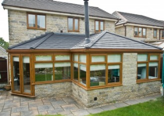 A Conservatory Conversion with an Insulated & Solid Tiled Roof System